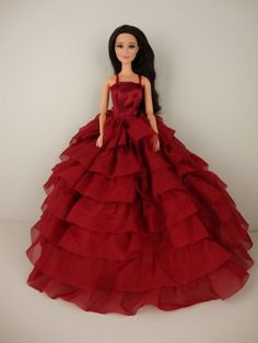 A Deep Red Gown with Layers of Ruffle Details Made to Fit the Barbie Doll Olivia's Doll Closet,http://www.amazon.com/dp/B00EDYM9X0/ref=cm_sw_r_pi_dp_KlQHsb041BYR6GQ6