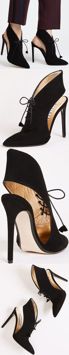 Pointed-toe Steiger pumps crafted in luxe suede. Petite tassels trim the laces.