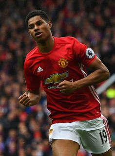 Marcus Rashford of Manchester United celebrates scoring his sides first goal during the Premier League match between Manchester United and Chelsea at Old Trafford on April 16, 2017 in Manchester, England.