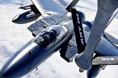 A KC-135 Stratotanker provides aerial refueling to an F-15 Eagle over the Joint Pacific Alaska Range Complex during Red Flag-Alaska, April 28, 2011. The F-15 pilot is assigned to the 44th Fighter Squadron, Kadena Air Base, Japan, and the KC-135 crew is assigned to the 92nd Air Refueling Wing, Fairchild Air Force Base, Wash. U.S. Air Force photo by Staff Sgt. Miguel Lara III