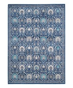 Take a look at this Blue & Ivory Arabesque Distressed Rug today!