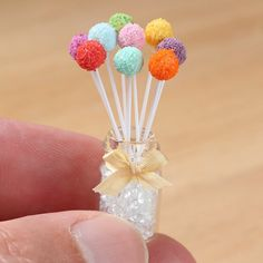 Miniature rainbow cake pops with glass jar decorated with a pretty bow www.parisminiatures.etsy.com
