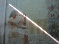 Holding a laser beam. False door, Temple at Saqqara