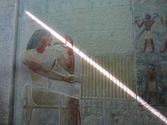 Holding a laser beam. False door, Temple at Saqqara