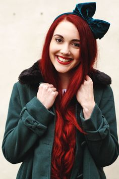 Love how the velvet green clashes with her gorgeous red mane!