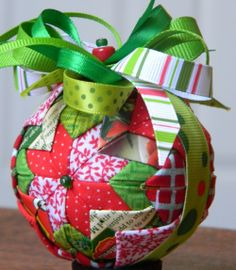 Christmas ornament made from scraps of fabric or paper - very cool idea to use up left over fabric or scraps from other Christmas projects and as a bonus it will look like it was your plan to co-ordinate all along