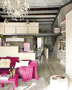 I wish I could do this...how cute is the little pink refrigerator in the kitchen?!