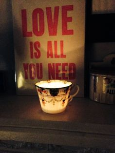 A pretty cup candle at night