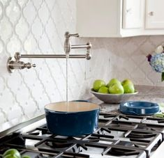 I LOVE this tile and the faucet over the stove is a great idea!