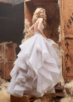 Hayley Paige (Style HP6413) DORI : Alabaster tulle bridal gown with halter high neck alabaster and crystal bodice, full horse hair flounced skirt and chapel train.