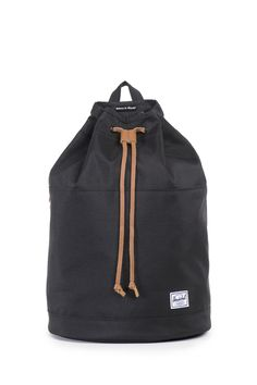 Oh my goodness! Herschel Supply Co is slowly launching their women's line and I am head over heels for this compact, cinch top backpack. Black + Camel leather for the win!