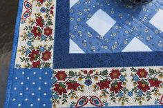 Brighten your home or summer porch with this cheerful quilted table topper.