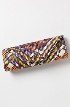32 Ways to Get the Tribal Look From the Spring 12 Runways, All Under $50: For something authentically ethnic, consider this handwoven clutch by artisans of Banago, which is crafted from colored wild grasses.  Anthropologie Mayumi Clutch ($48)