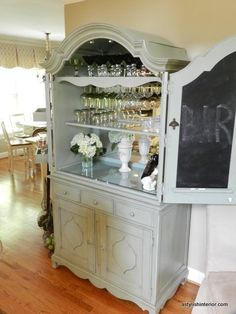 A Stylish Interior: Paula Deen Bar Armoire (i'm in love. I want our glasses organized and hanging on racks but still sort of hidden so as not to collect too much dust) - May 18 2019 at Armoire Bar, Armoire Redo, Armoire Makeover, Furniture Makeover, Bar Hutch, Furniture Projects, Home Projects, Diy Furniture, Paula Deen
