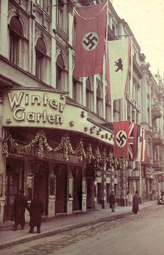 Soldier: Berlin Under SS Rule Germany WW II. This picture just overwhelms me with the amount of Nazi flags