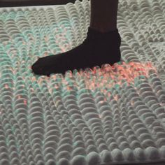 """Bio-surfaces containing """"hacked"""" bacteria could clean your feet as you walk on them"""