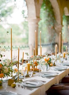 Gold and peach rustic wedding, long tapers and light blue placesetting