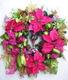 "The wreath is embellished with magenta Poinsettias, bright green Poinsettias, and Shatterproof Christmas magenta/bright green Ornaments. The wreath is accented with lots of sparkle pink,green,gold leaves. There is a very pretty magenta/green Ornament in the middle. I finish the wreath with two magenta/bright green Ribbon Bows.   The wreath measures from tip to tip at 26"" (L) x 26"" (W) x 7.5""(D)."