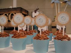 Baptism cupcake - Vanilla cupcake with chocolate icing.  Personalised cupcake topper to match with brown and blue theme.