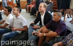 The Duke of Cambridge plays computer games as he visits the Agenzija Appogg Access Centre for young people in Vittoriosa, Malta on the second day of his visit to the island.