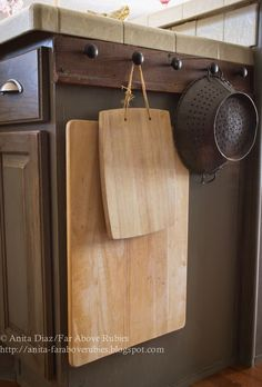 This is a great idea for storing often used cutting boards.  Should work well on island in RV!