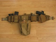A simple Battle Belt with some Kydex, a few extra mags, and a dump pouch for your empty and/or Glock mags Military Gear, Military Equipment, War Belt, Battle Belt, Assault Pack, Mens Toys, Tac Gear, Shooting Gear, Chest Rig