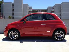 Very nice red Fiat 500.This is my present car