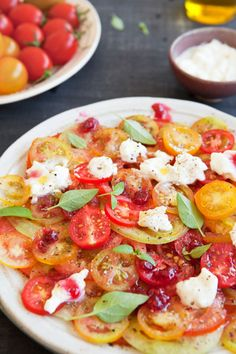 TOMATO CARPACCIO Heirloom and cherry tomatoes sliced carpaccio thin  1.Marinate tomatoes with olive oil, lime juice, balsamic vinegar and parmesan  2.Layer the tomatoes on a serving platter  3.Add thinly sliced red onion and capers.  4. Add mozarella boconccinis if you like.