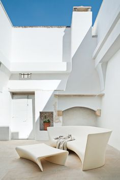 Sun-drenched courtyard. Ludovica + Roberto Palomba.