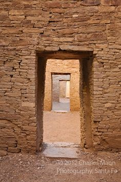 Light filters down between doors of layered stone inside the Pueblo Bonito Ruin at Chaco Culture National Historical Park in Chaco Canyon in Northwestern New Mexico