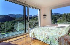 Bedroom upstairs with wonderful view on the mountains.
