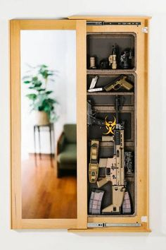 Tactical Wall Concealment (large) Multiple finishes available to fit any home interior desire ... http://tacticalwalls.com/shop/1450-bundle/