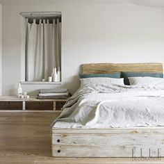 Durable wood floors inject warmth into this bedroom, whose wide-plank design creates a feeling of space<span>Photography: Fabrizio Cicconi  Styling: Francesca Davoli/Living Inside