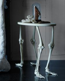 The legs can't stand up to heavy weights, but how AWESOME is this table? #halloween #skeleton #martha