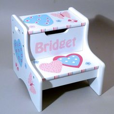 Check out our Personalized White Two Step Stool, which gives kids more height to reach stuff. It is custom hand painted in your choice of designs and colors. $69.95
