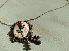 Red rose cross stitch pendant on bronze frame, charm necklace, cross stitch jewelry Cross Stitch Rose, Red Roses, Custom Design, Vintage Fashion, Bronze, Pendant Necklace, Antique, Chain, Handmade