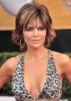 lisa rinna hair - prooves you don't need long hair and/or extensions to look sexy. Getting my hair done like this Thursday but doing cherry red highlights........(maybe)