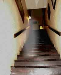 I FELT A COLD SPOT AS I CAME DOWN THE STAIRS SAYS DAVID FIERELLI, SO I TURNED AND SNAPPED A PICTURE OF A GHOST.