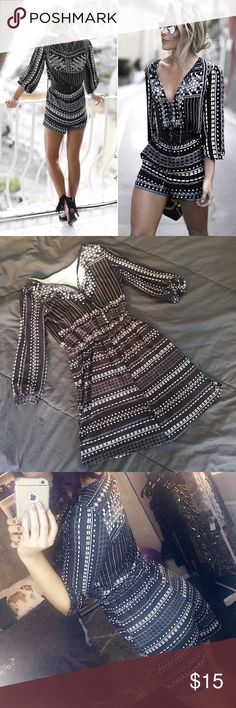 NEW Stylish Black White Graphic Print Romper Small To the trend black and white romper! Super cute and stylish, has a nice stretch to it. Brand new and never worn! Size xs-small. Dresses