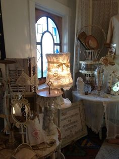 a vintage lamp frame draped in antique linens and lace