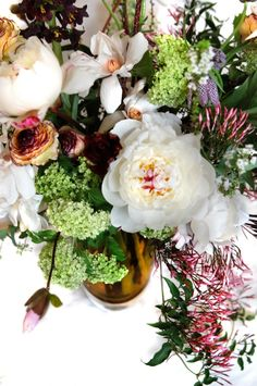 Early Spring flower arrangement with Peonies, Magnolia, Frittiliaria, Jasmine, Parrot tulips,Ranunculus,Bearded Iris and Viburnum