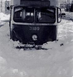 This PCC streetcar bound for Boston College on Comm. Ave., Brighton during the Blizzard of 1978 almost made it.