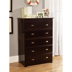 This solid wood dresser features unique frame constructed side panels. With a gorgeous espresso finish and five sturdy drawers on metal Euro style guides, this dresser will pair perfectly with any home decor.