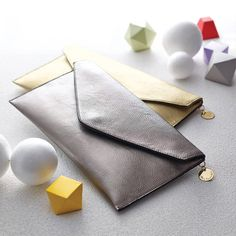 personalised metallic clutch bag by lily belle | notonthehighstreet.com
