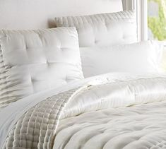 Silk Tufted Quilt & Shams #potterybarn This gorgeous, hand-quilted bedding is a must-have layer for every bed. Handwoven of a silk/cotton blend. Polyester batting. Quilted sham has an invisible zipper closure. Quilt, sham and insert sold separately. Dry-clean. Imported.