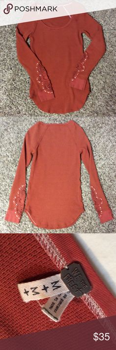 We the free Synergy thermal Long-sleeved thermal  rust colored with cuff  trim. Size M. Picture #4 shown with a red thermal for contrast. EUC. Free People Tops Tees - Long Sleeve