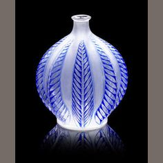René Lalique Malines a Vase, design 1924 clear glass, frosted and polished, with strong blue staining 12cm high, engraved R.Lalique, France