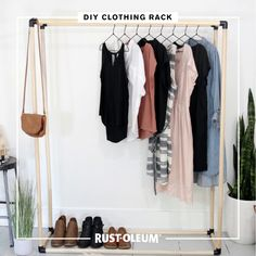 Dress up your closet space with this DIY clothing rack The MerryThought made with Rust-Oleum Universal Matte spray paint and Varathane premium wood stain. Make space for clothes and compliments with this project that will put your decor and your DIY skills on display. Don't get hung up on overpriced furnishings—take organization into your own hands with this makeshift closet that will look good in any room. #prideinthemaking #DIY #spraypaint #stain #wood #homedecor #closet #organization