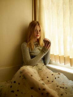 Elle Fanning wears Dior sweater and tulle skirt