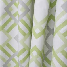 A fresh, geometric lattice fabric in soft grey and a tender green on a white background.Suitable for drapery, curtains, roman blinds, upholstery, pillows, showe
